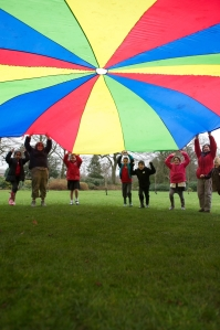 Parachute games in the orchard at artists workshops