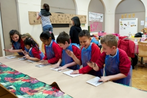 Schoolchildren enjoying printing at one of the art workshops